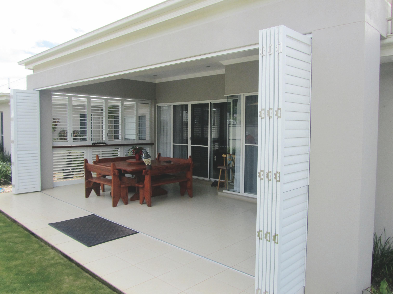 Enclosing a pergola or alfresco area with plantation shutters